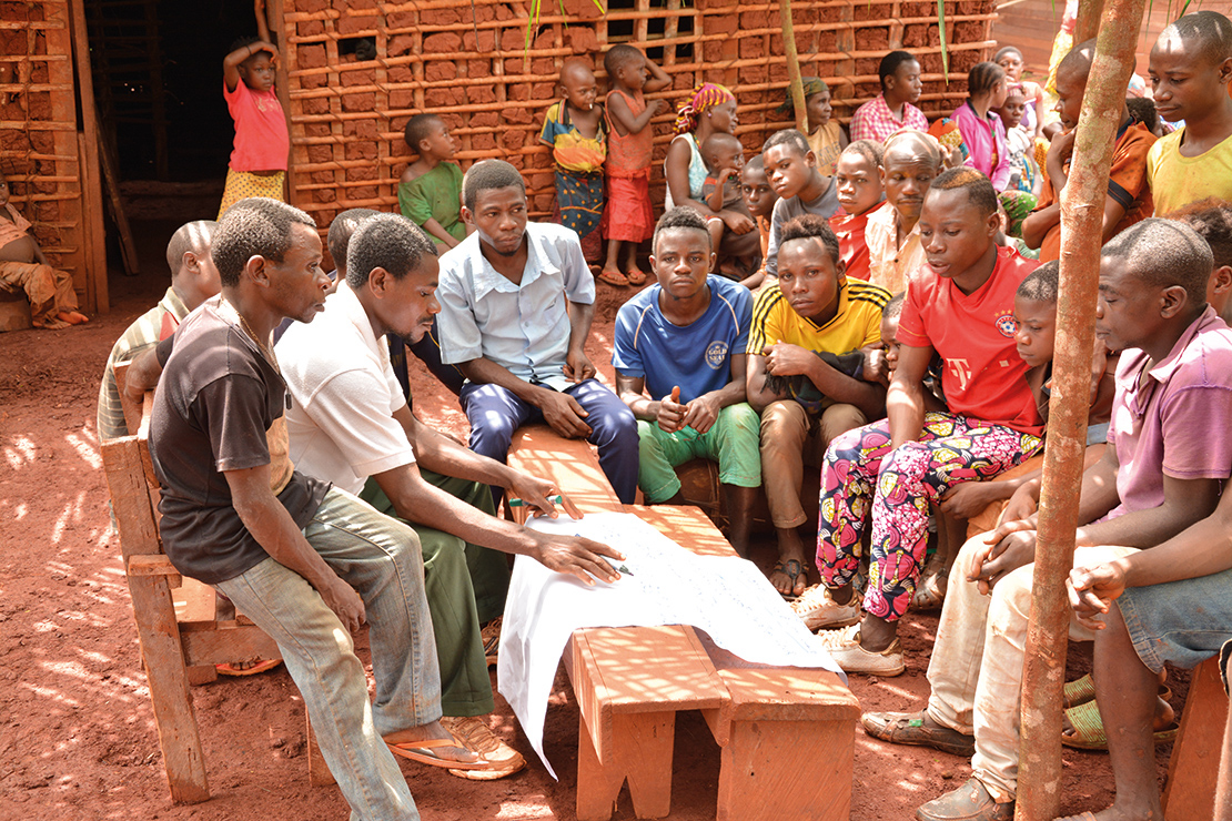 Participating in a community planning meeting in Dioula, Mambele, Cameroon. Credit: Viola Belohrad.