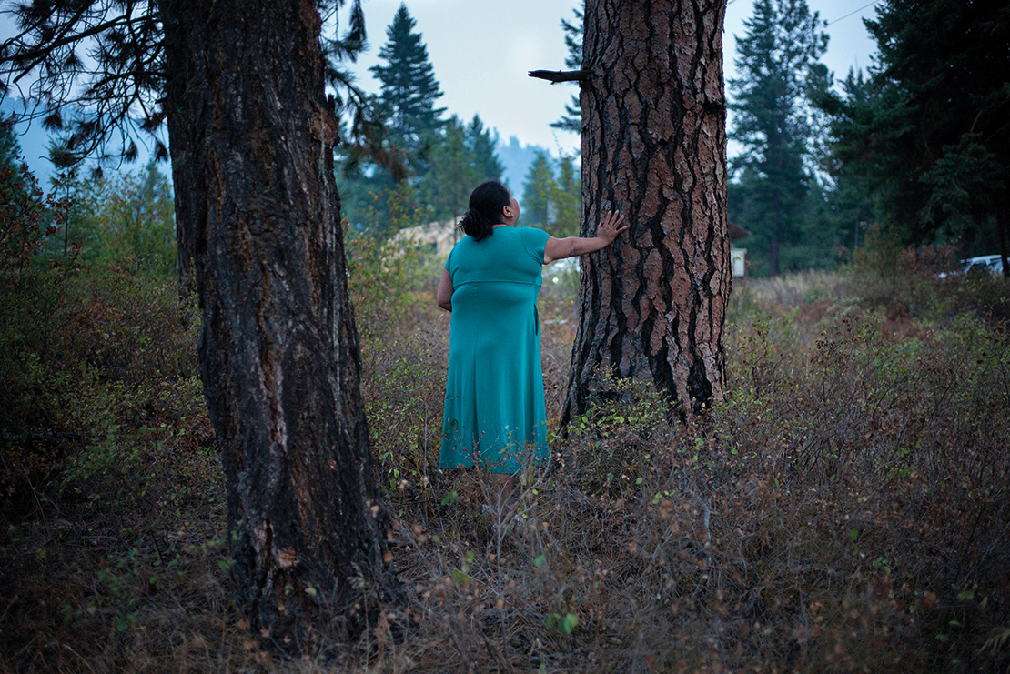 A woman carries out an offering ceremony at the Tiny House Warriors' camp. The Tiny House Warriors are a group of activists who constructed a series of homes in the path of the Trans Mountain oil sands pipeline development. Credit: Ian Willims.