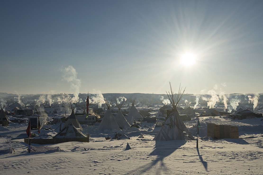 Early morning at Oceti Sakowin Camp, one of the protest camps formed to block the development of the Dakota Access Pipeine in the USA. Credit: Photo Image.
