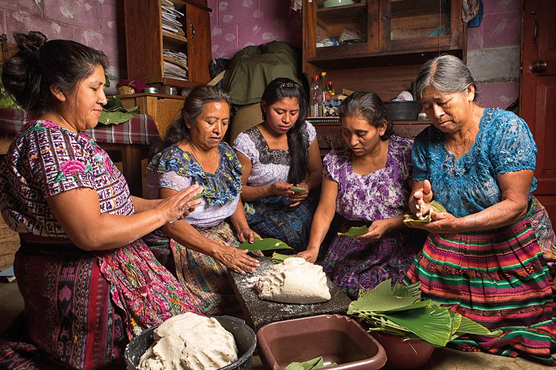 Tzutujil women preparing traditional food together in San Pedro la Laguna, Guatemala. Credit: Barna Tanka